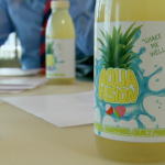 Big Dawg passion fruit drink takes on Aquafusion pineapple drink on The Apprentice  2014 advertising task in New York