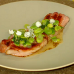 Bacon Chop with broad beans and broad beans flowers on Spring Kitchen with Tom kerridge
