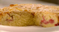 Rachel Allen makes a bakewell cake with raspberries on Rachel Allen's Cake Diaries. The ingredients are: 150 g butter, softened, plus extra for greasing, 150 g caster sugar, 2 eggs,A...