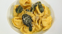Theo Randall cooks squash filled tortellini in sage butter sauce on The Chef's Protege. The ingredients are: 1 small butternut squash, 125g of unsalted butter, 1 garlic clove, sliced, 1...