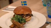 Ainsley Harriott help to serve up tasty Swedish hash and reindeer burger at the Stockholm Restaurant and Deli in London on Len and Ainsley's Big Food Adventure.