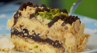 "Mary Berry showcased her delicious Marjolaine cake in dessert week on The Great British Bake Off. Mary says: ""This cake combines layers of nutty meringue, praline buttercream and chocolate ganache...."