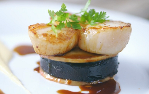 James Martin served up scallops with black pudding burger in a apple, calvados and butter sauce on James Martin's French Adventure. The ingredients includes: pink lady apples, butter, calvados, black...