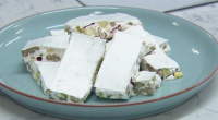 John Whaite served up nougat with cranberries and nuts on Chopping Block. The ingredients include: glucose syrup, sugar, water, runny honey, roasted pecan nuts, blanched almonds, pistachio nuts, dried cranberries...