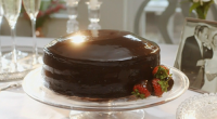"Mary Berry served up a chocolate reflection cake with mirror icing, apricot jam and Scots whisky cream on Mary Berry Everyday. Mary says: ""This is a dazzling cake that's perfect..."