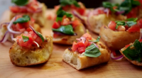 Matt Tebbutt served up tomato bruschetta with sausage rolls, mini burgers and a jelly and ice cream mountain dessert for the Wilkinson's family party food on Save Money: Good Food....