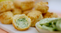 Nadiya Hussain served up cheese scones with chive butter sauce on Nadiya's British Food Adventure. The ingredients are: 175g self-raising flour, 50g strong white flour, plus extra for dusting, ¼...