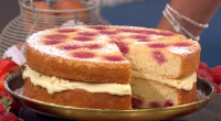 John Whaite served up a raspberry and white chocolate melting cake on today's episode of Lorraine. See the recipe in John's book titled: John Whaite Bakes At Home, available from...