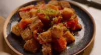 Nigella Lawson served up tomato and fried bread hash with banana shallots on Nigella: At My Table. The ingredients include: bloomer white bread, olive oil, banana shallot, salt, pepper, Worcestershire...