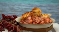 Gino D'Acampo served up Calabrian-style king prawns with capers and black olives in a spicy tomato sauce on Gino's Italian Coastal Escape. The ingredients are: 6 tablespoons extra virgin olive...