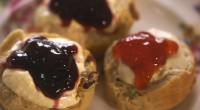 Mary Berry served up classic plain and sultana scones with jam and clotted cream for a Devon cream tea on Mary Berry's Country House Secrets. The ingredients are: 450g self-raising...
