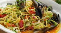Jamie Oliver served up a tasty seafood linguine with baby capers and cherry tomatoes on Sunday Brunch. The ingredients are: 1 clove of garlic, 1 heaped teaspoon baby capers, 3...