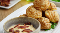 Simon Rimmer served up gougeres with bacon and a mustard dip on Sunday Brunch. The ingredients are: 125ml water, 125ml milk, 100g butter, 1 tsp sea salt, 125g flour, 4...
