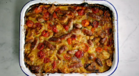 "Jamie Oliver served up comforting sausage bake with cherry tomatoes, white beans and chipolatas on Jamie's Quick & Easy Food. Jamie says: ""This dish is like a savoury bread and..."