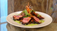 Wolfgang Puck serves up lamb chops with aubergines (eggplants) and a coriander and mint vinaigrette on Saturday kitchen. The ingredients for the marinated lamb chops are: 225ml mushroom soy sauce,...