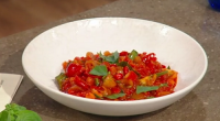 Anna Haugh served up a tasty vegan Spanish stew with spicy peppers on Saturday Kitchen. The ingredients are: 50ml extra virgin olive oil, plus 2 tbsp to serve, 3 garlic...