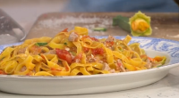 Jamie Oliver served up a tasty Italian feast with fettuccine pasta, tuna, anchovies, courgette, nuts and tomato on This Morning. The ingredients are: 50g whole almonds, 1 small onion, 2...