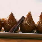 Ainsley Harriott Blue mountain coffee and rum poached pears with crunchy coconut crumb recipe on Ainsley's Caribbean Kitchen
