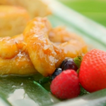 Ainsley Harriott pineapple French toast with caramelised coconut, rum and bananas recipe on Ainsley's Caribbean Kitchen