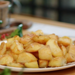 Lisa Faulkner crispy roast potatoes with rosemary and semolina recipe on John and Lisa's Weekend Kitchen