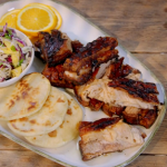 Ainsley Harriott jerk pork belly with roti and coconut and mango slaw recipe on Ainsley's Food We Love