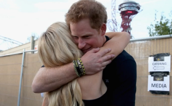 Prince Harry and Ellie Goulding have been seen embracing and the photo of the encounter was shown on today's episode of This Morning.