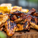 John Torode pork ribs with chicken wings recipe on John and Lisa's Weekend Kitchen