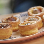 Lisa Faulkner Yorkshire puds with sausage balls and onion gravy recipe on John and Lisa's Weekend Kitchen