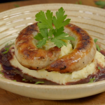 Ainsley Harriott sausages with mustard mash and a onion and red wine gravy recipe on Ainsley's Food We Love