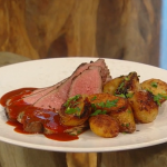 Matt Tebbutt butterflied leg of lamb with garlic dressing, smoked onions, caraway roasted potatoes and barbecue gravy recipe on Saturday Kitchen