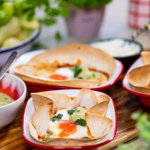 Lisa Faulkner spiced baked eggs (Huevos Rancheros ) with black beans and tortilla wraps recipe on John and Lisa's Weekend Kitchen