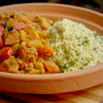Ainsley Harriott butternut squash, spinach and sweet potato tagine with lemon and pistachio couscous recipe on Ainsley's Mediterranean Cookbook