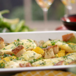 Lisa Faulkner smoked haddock chowder traybake with pancetta, leeks and sweetcorn recipe on John and Lisa's Weekend Kitchen